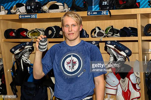 Patrik Laine of the Winnipeg Jets poses with his pucks after scoring his first career NHL hat trick in a 54 overtime win over the Toronto Maple Leafs...