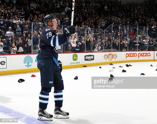 Patrik Laine of the Winnipeg Jets salutes the fans after being named the first star of the game following his first career hat trick in a 54 overtime...