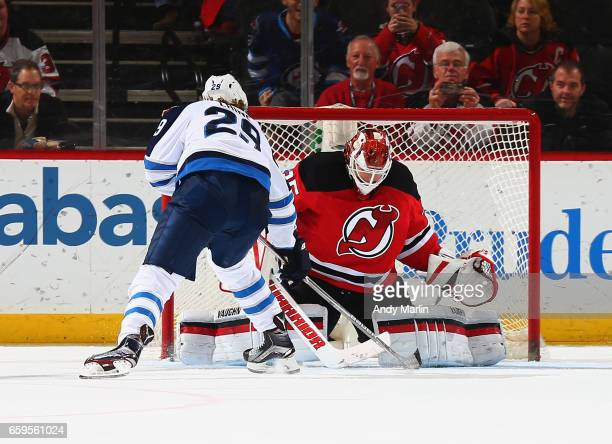 Patrik Laine of the Winnipeg Jets scores the game deciding goal in a shootout against the New Jersey Devils at Prudential Center on March 28 2017 in...