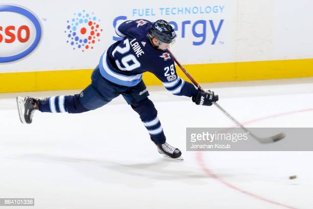 Patrik Laine of the Winnipeg Jets shoots the puck on goal during second period action against the Minnesota Wild at the Bell MTS Place on October 20...