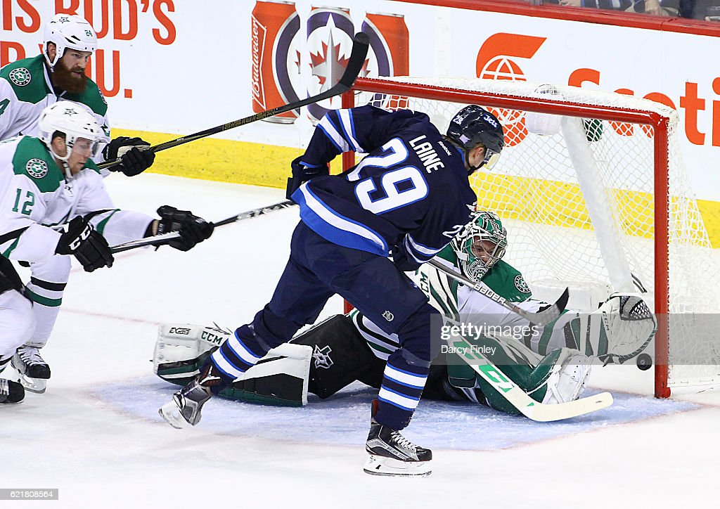 Patrik Laine #29 of the Winnipeg Jets shoots the puck past a sprawling Kari Lehtonen #32 of the Dallas Stars during second period action at the MTS Centre on November 8, 2016 in Winnipeg, Manitoba, Canada.