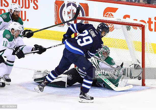 Patrik Laine of the Winnipeg Jets shoots the puck past a sprawling Kari Lehtonen of the Dallas Stars during second period action at the MTS Centre on...