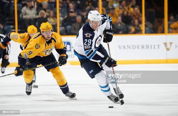 Patrik Laine of the Winnipeg Jets skates against Filip Forsberg of the Nashville Predators during an NHL game at Bridgestone Arena on March 13 2017...