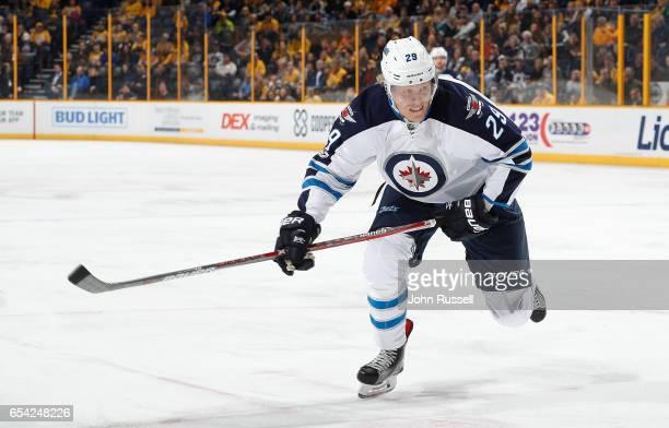 Patrik Laine of the Winnipeg Jets skates against the Nashville Predators during an NHL game at Bridgestone Arena on March 13 2017 in Nashville...