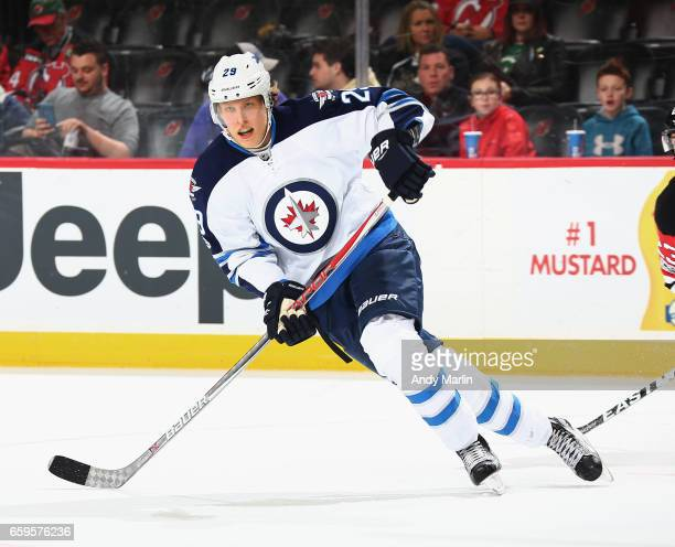 Patrik Laine of the Winnipeg Jets skates against the New Jersey Devils during the game at Prudential Center on March 28 2017 in Newark New Jersey