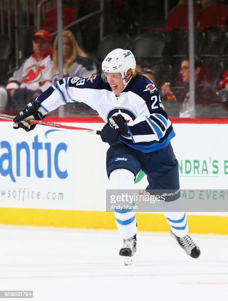 Patrik Laine of the Winnipeg Jets skates in the firstperiod during the game against the New Jersey Devils at Prudential Center on March 28 2017 in...