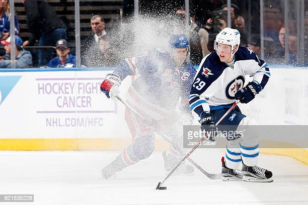 Patrik Laine of the Winnipeg Jets skates with the puck against Ryan McDonagh of the New York Rangers at Madison Square Garden on November 6 2016 in...