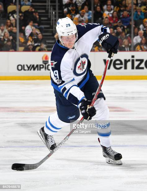 Patrik Laine of the Winnipeg Jets takes a shot against the Pittsburgh Penguins at PPG Paints Arena on February 16 2017 in Pittsburgh Pennsylvania