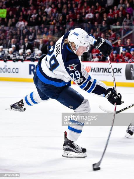 Patrik Laine of the Winnipeg Jets takes a shot during the NHL game against the Montreal Canadiens at the Bell Centre on February 18 2017 in Montreal...