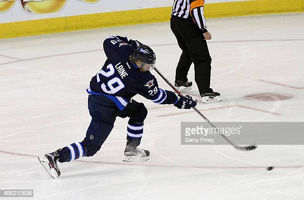 Patrik Laine of the Winnipeg Jets takes a shot on goal during second period action against the Colorado Avalanche at the MTS Centre on December 18...