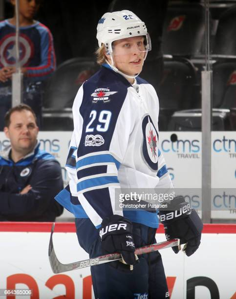 Patrik Laine of the Winnipeg Jetslooks on during warm ups prior to the game against the New Jersey Devils on March 28 2017 at the Prudential Center...