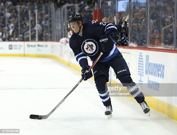 Patrik Laine playing his first NHL game of the Winnipeg Jets looks to make a pass against the Carolina Hurricanes during NHL action on October 22...