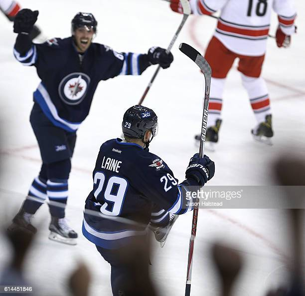 Patrik Laine playing his first NHL game of the Winnipeg Jets celebrates scoring his first NHL goal against the Carolina Hurricanes during NHL action...