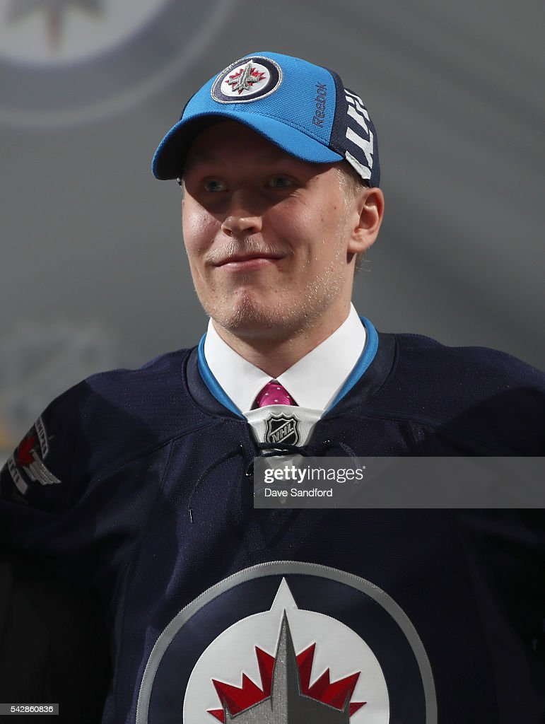 Patrik Laine poses for a photo onstage after being selected second overall by the Winnipeg Jets during round one of the 2016 NHL Draft at First Niagara Center on June 24, 2016 in Buffalo, New York.
