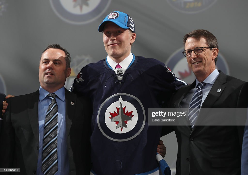 <a gi-track='captionPersonalityLinkClicked' href=/galleries/search?phrase=Patrik+Laine&family=editorial&specificpeople=13600427 ng-click='$event.stopPropagation()'>Patrik Laine</a> poses onstage for a photo with executive chairman Mark Chipman, right, of the Winnipeg Jets and team personnel after being selected second overall by the Winnipeg Jets during round one of the 2016 NHL Draft at First Niagara Center on June 24, 2016 in Buffalo, New York.