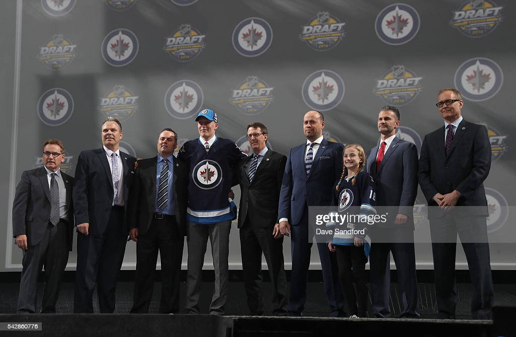 Patrik Laine poses onstage with the Winnipeg Jets team personnel after being selected second overall by the Winnipeg Jets during round one of the 2016 NHL Draft at First Niagara Center on June 24, 2016 in Buffalo, New York.