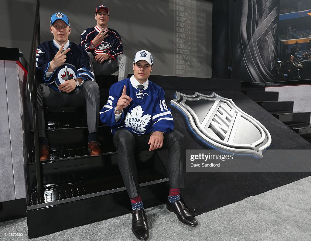 Patrik Laine, selected second overall by the Winnipeg Jets, Pierre-Luc Dubois, selected third overall by the Columbus Blue Jackets, and Auston Matthews, selected first overall by the Toronto Maple Leafs, pose onstage for a group photo during round one of the 2016 NHL Draft at First Niagara Center on June 24, 2016 in Buffalo, New York.