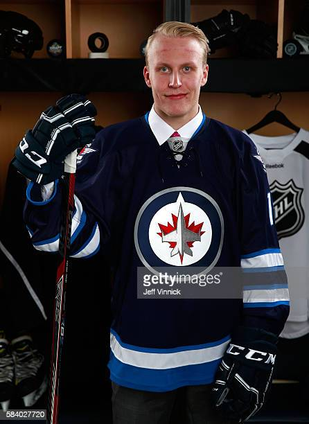 Patrik Laine selected second overall by the Winnipeg Jets poses for a portrait during round one of the 2016 NHL Draft at First Niagara Center on June...