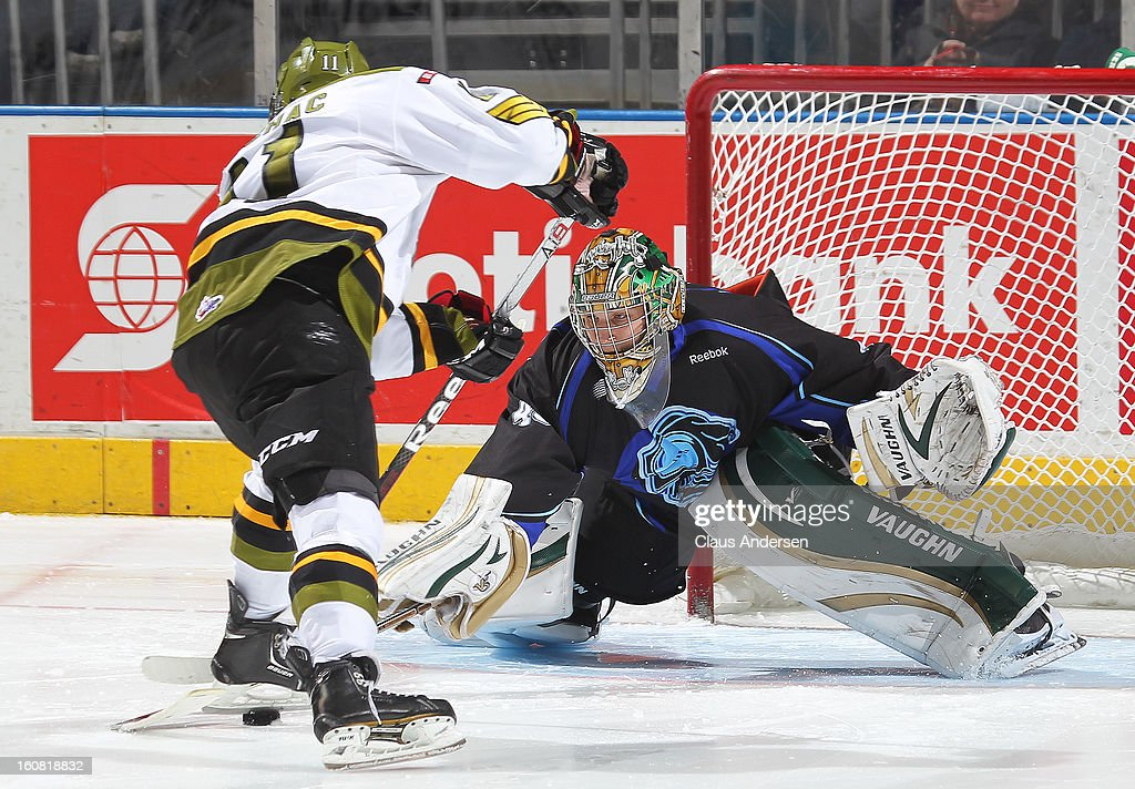 Patrik Machac #11 of the Brampton Battalion is poke checked by Anthony Stolarz #43 of the London Knights in the shoot-out in an OHL game on February 1, 2013 at the Budweiser Gardens in London, Canada. The Knights defeated the Battalion 1-0 in a shoot-out.