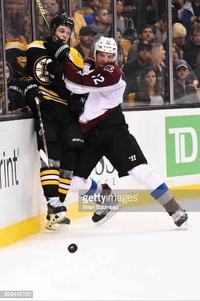 Patrik Nemeth of the Colorado Avalanche checks against Anders Bkork of the Boston Bruins at the TD Garden on October 9 2017 in Boston Massachusetts