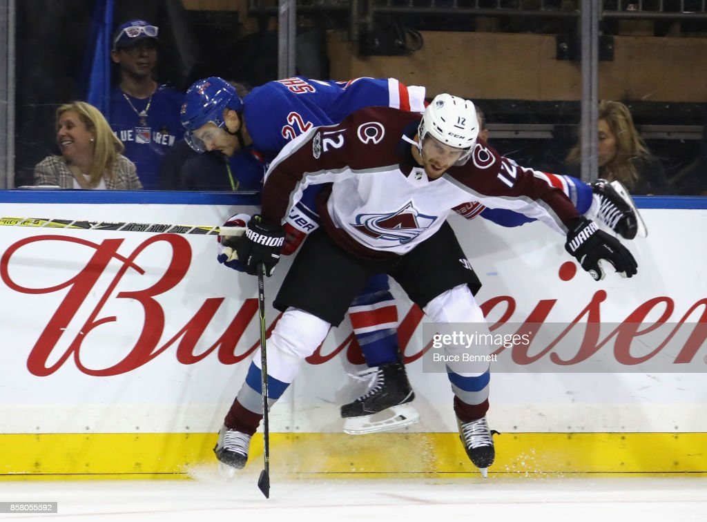 Patrik Nemeth #12 of the Colorado Avalanche checks Kevin Shattenkirk #22 of the New York Rangers into the boards during the second period at Madison Square Garden on October 5, 2017 in New York City.