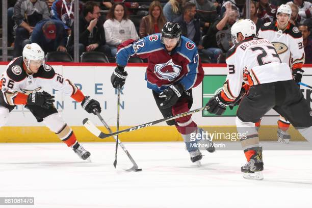 Patrik Nemeth of the Colorado Avalanche skates between Francois Beauchemin and Brandon Montour of the Anaheim Ducks at the Pepsi Center on October 13...