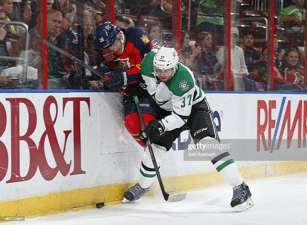 Patrik Nemeth of the Dallas Stars and Bobby Butler of the Florida Panthers battle along the boards for a loose puck at the BBT Center on April 6 2014...