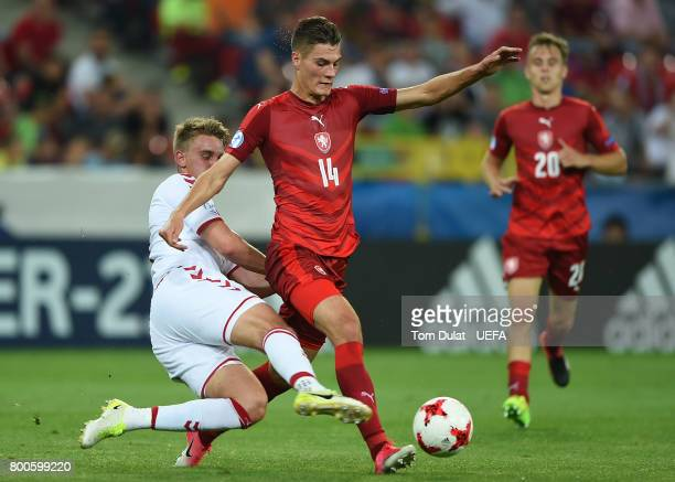 Patrik Schick of Czech Republic and Andreas Maxso of Denmark battle for the ball during the UEFA European Under21 Championship Group C match between...