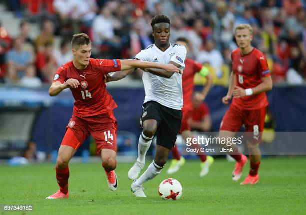 Patrik Schick of Czech Republic and Gideon Jung of Germany during their UEFA European Under21 Championship match on June 18 2017 in Tychy Poland