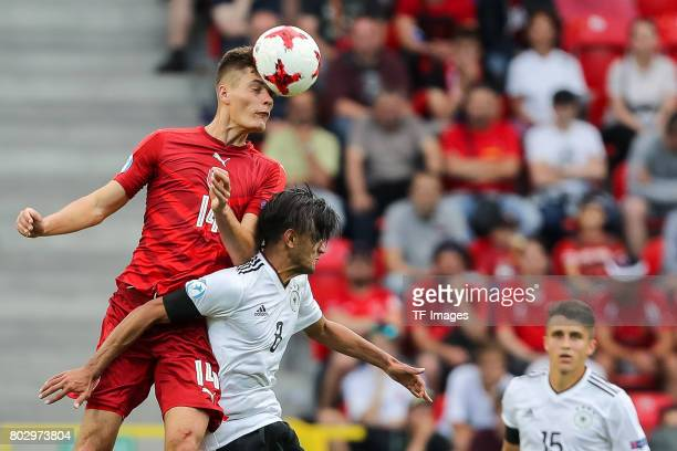 Patrik Schick of Czech Republic and Mahmoud Dahoud of Germany battle for the ball during the UEFA European Under21 Championship Group C match between...
