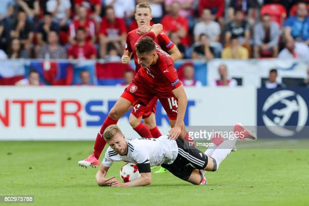 Patrik Schick of Czech Republic and Mitchell Weiser of Germany battle for the ball during the UEFA European Under21 Championship Group C match...