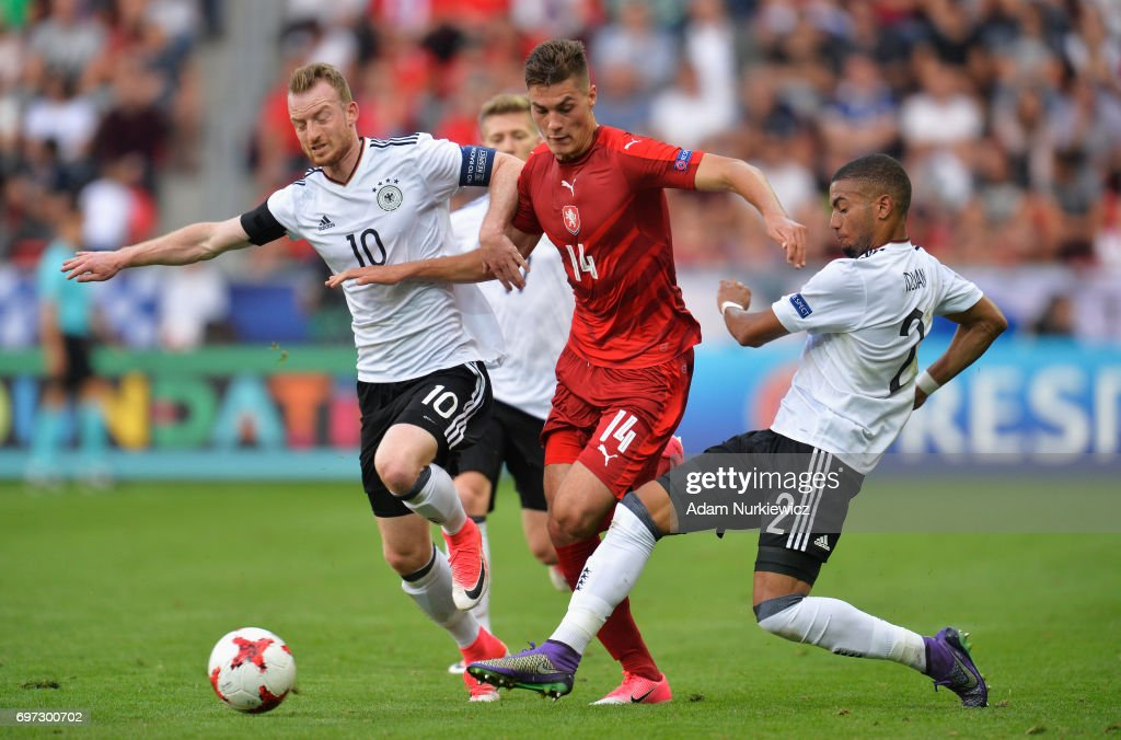 Patrik Schick of Czech Republic attempts to get past Maximilian Arnold of Germany and Jeremy Toljan of Germany during the UEFA European Under-21 Championship Group C match between Germany and Czech Republic at Tychy Stadium on June 18, 2017 in Tychy, Poland.