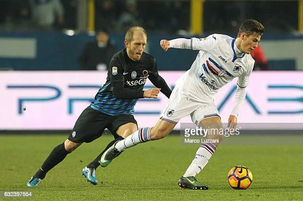 Patrik Schick of UC Sampdoria is challenged by Andrea Masiello of Atalanta BC during the Serie A match between Atalanta BC and UC Sampdoria at Stadio...