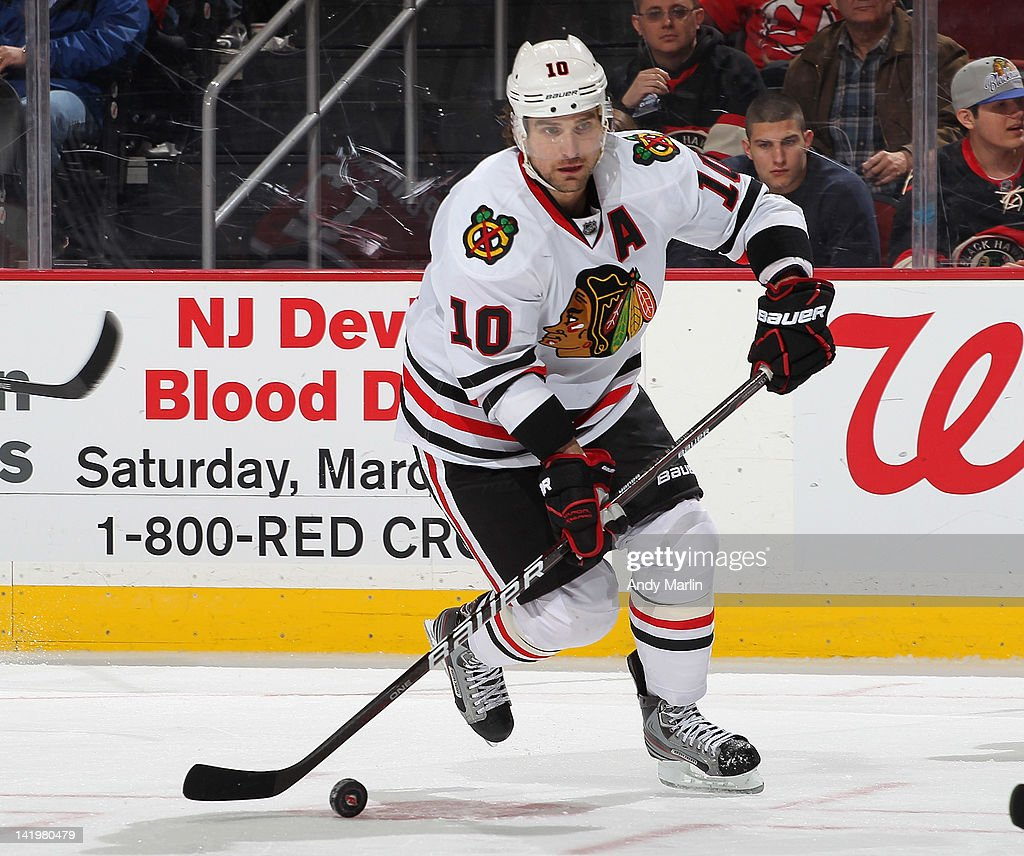 Patrik Sharp #10 of the Chicago Blackhawks controls the puck against the New Jersey Devils during the game at the Prudential Center on March 27, 2012 in Newark, New Jersey.