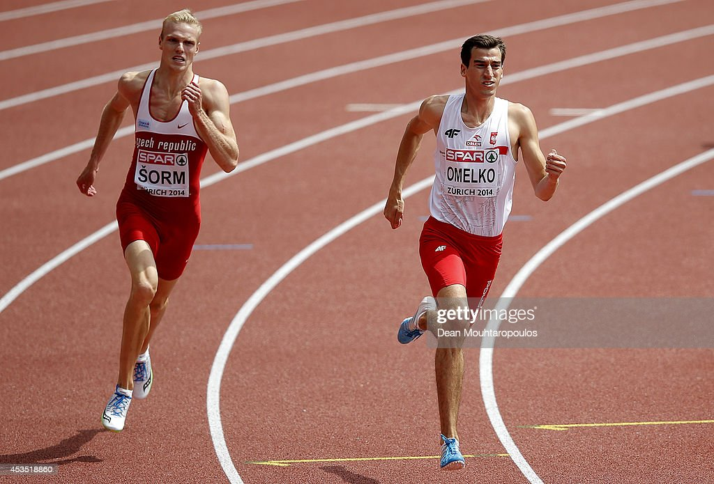 Patrik Sorm of the Czech Republic (L) and Rafal Omelko of Poland compete in the Men's 400 metres heats during day one of the 22nd European Athletics Championships at Stadium Letzigrund on August 12, 2014 in Zurich, Switzerland.