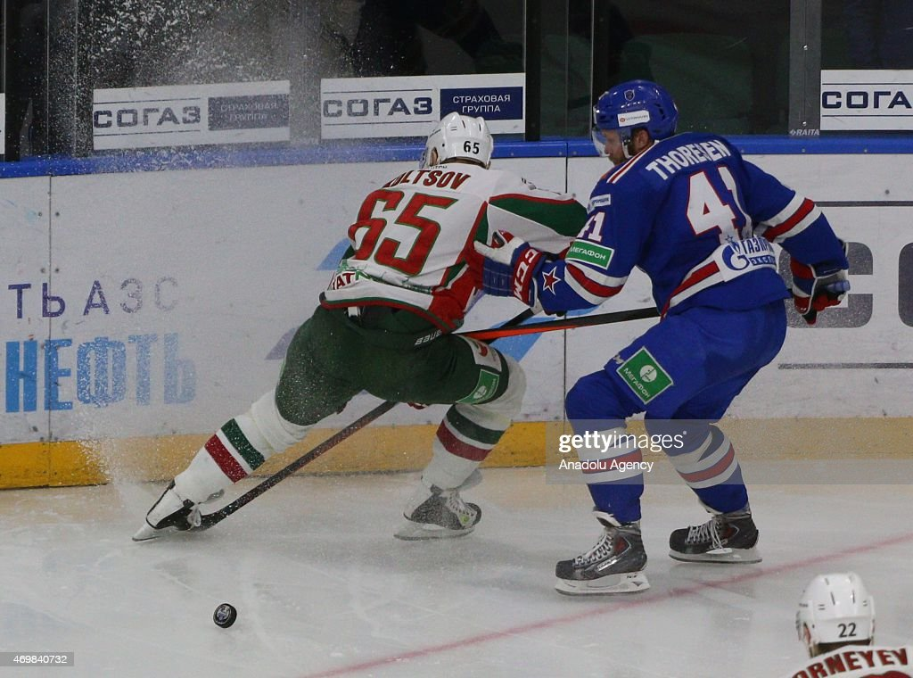 Patrik Thoresen (41) of SKA St.-Petersburg in action with <a gi-track='captionPersonalityLinkClicked' href=/galleries/search?phrase=Konstantin+Koltsov&family=editorial&specificpeople=203229 ng-click='$event.stopPropagation()'>Konstantin Koltsov</a> (65) of AK Bars Kazan during the 3rd match of final series of Gagarin cup between SKA St.-Petersburg and AK Bars Kazan at the Ice palace in Saint-Petersburg , Russia on April 15, 2015.