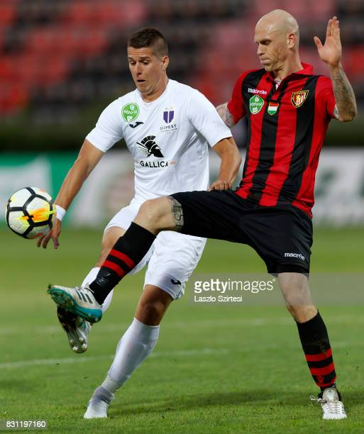 Patrik Tischler of Ujpest FC duels for the ball with Botond Barath of Budapest Honved during the Hungarian OTP Bank Liga match between Budapest...