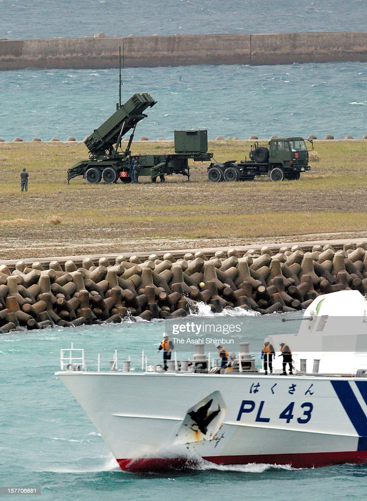 PAC-3 patriot missile is deployed while Japan Coast Guard vessel Hakusan patrols in preparation for the North Korea's long range missile launch on December 5, 2012 in Ishigaki, Okinawa, Japan. Japan deploys PAC-3 missiles to Okinawa and Tokyo in responce to North Korea's announcement that they will launch 'the satellite' between December 10 and 22.