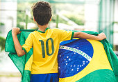 Brazilian Boy Holding the Flag of Brazil
