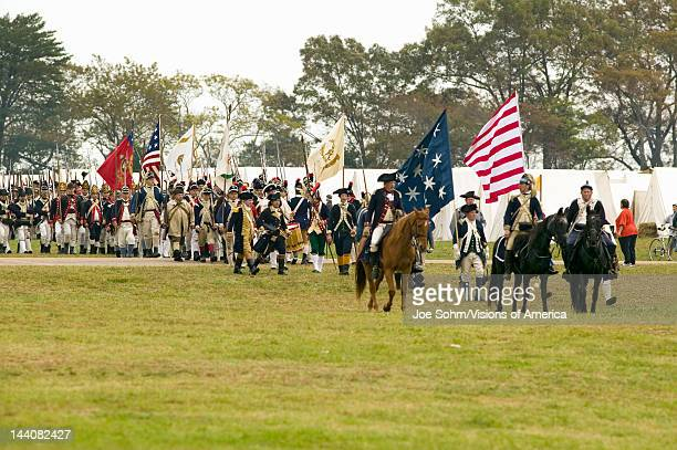 Patriot soldiers march to Surrender Field as part of the 225th Anniversary of the Victory at Yorktown a reenactment of the siege of Yorktown where...