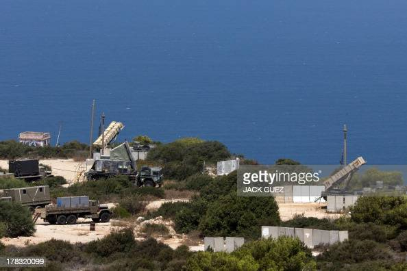 Patriot surfacetoair missile batteries are positioned in the Mediterranean coastal city of Haifa north of Israel on August 29 2013 The Israeli...