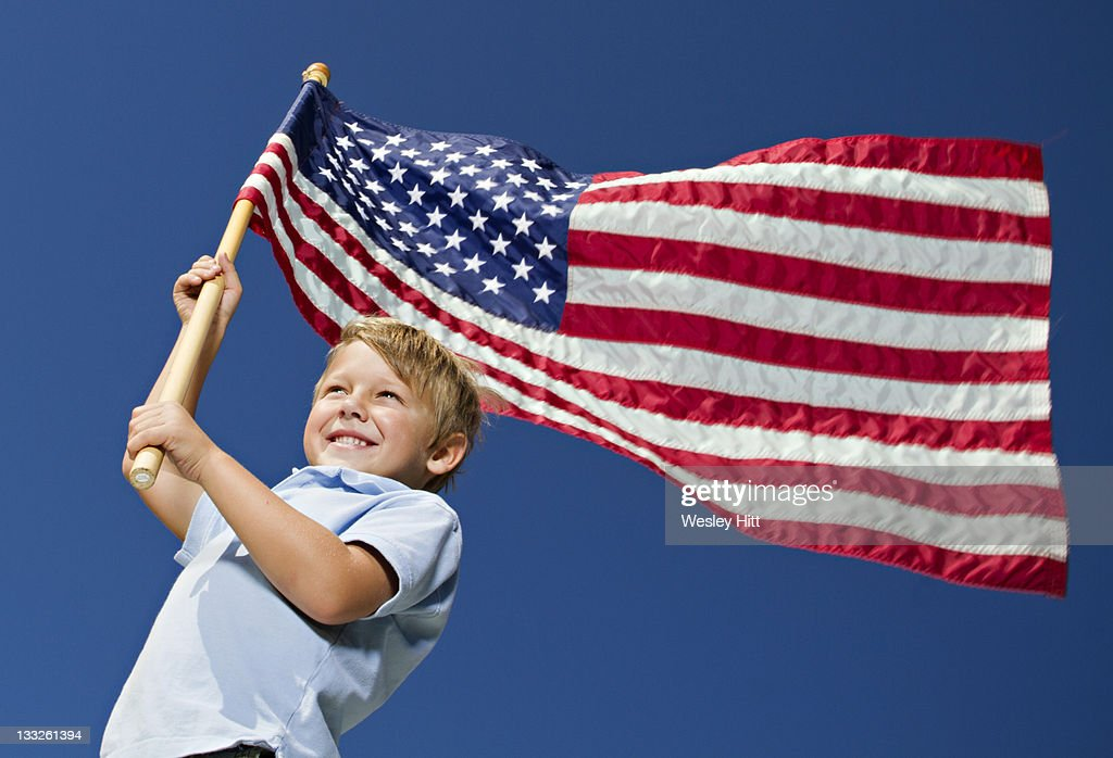 Patriotic boy with American Flag : Stock Photo