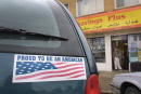 A patriotic bumper sticker adorns a van in front of an Arabic grocery store October 12 2001 in Dearborne MI Dearborn is home to the largest Arabic...