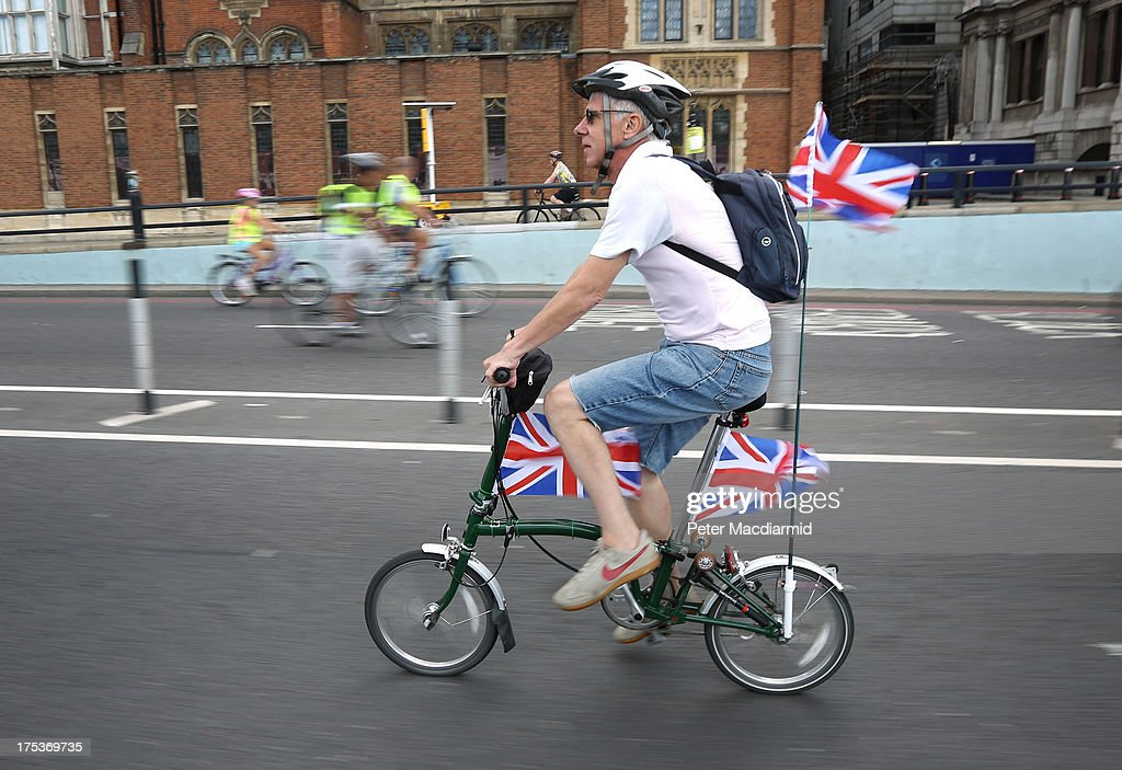 A patriotic cyclist flies three Union flags as he takes part in the Ride London Freecycle event on August 3, 2013 in London, England. Up to 50, 000 cyclists are expected to ride the eight mile traffic free route through central London.