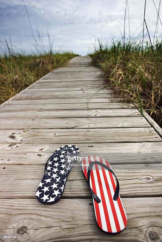 Patriotic flip-flops on boardwalk