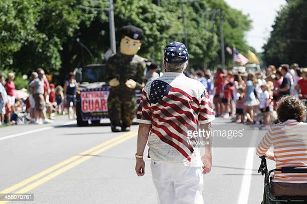 Patriotic Man Walking Toward July 4th Parade