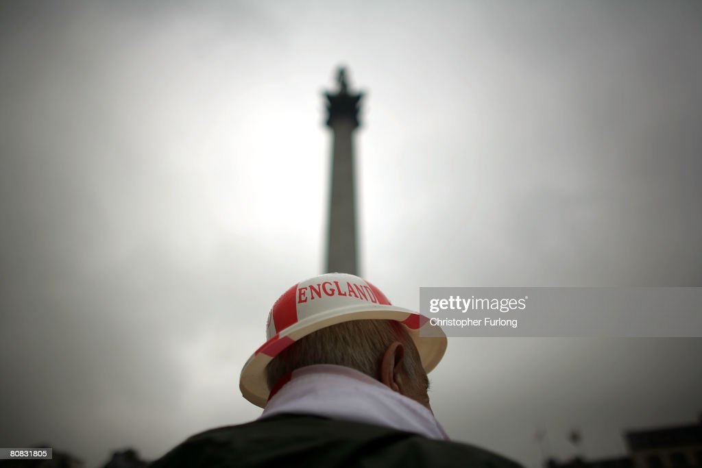 Patriotic pensioner Jim Diper braves the rain to don his plastic England bowler hat and join the festivities below Nelson's Column celebrating Saint Georges's Day in Trafalgar Square on 23 April, 2008, London England. The celebrations for England?s patron saint's day were organized by the Greater London Authority who also organize other cultural celebrations at Trafalgar Square including the hugely successful and colourful St Patrick?s Day and the Chinese New year festivities.