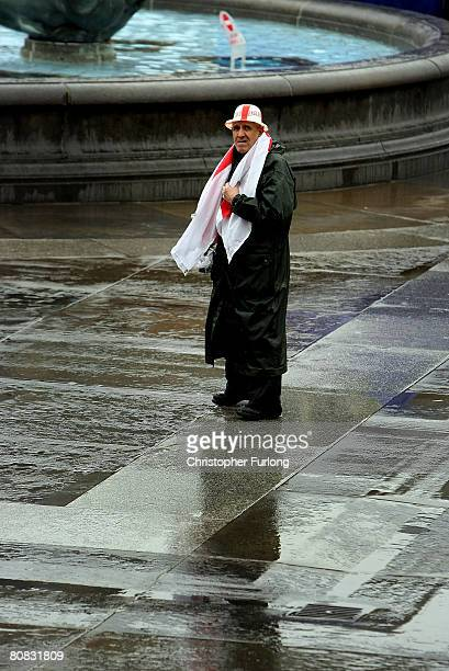 Patriotic pensioner Jim Diper braves the rain to don his plastic England bowler hat and join the festivities celebrating Saint Georges's Day in...