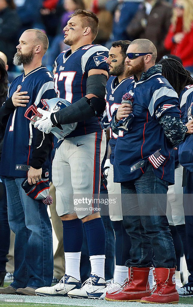 Patriots and Red Sox line up together during the singing of the national anthem, David Ross, Rob Gronkowski, Steve Gregory and Jonny Gomes (wearing some red boots) are included. The New England Patriots hosted the Pittsburgh Steelers in an NFL regular season game at Gillette Stadium, Nov. 3, 2013.