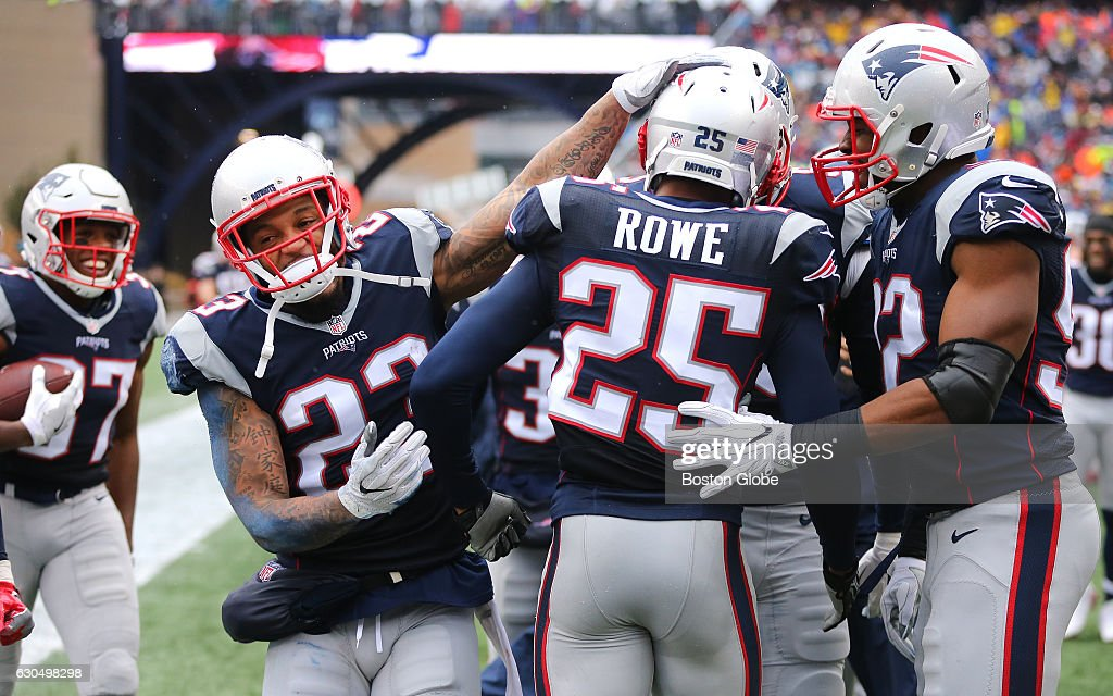 Patriots congratulate teammate Eric Rowe after getting an interception in the second quarter.